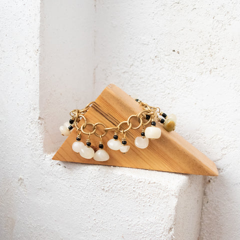 White moonstone bracelet on a wooden triangle in the Amani Chattanooga boutique.