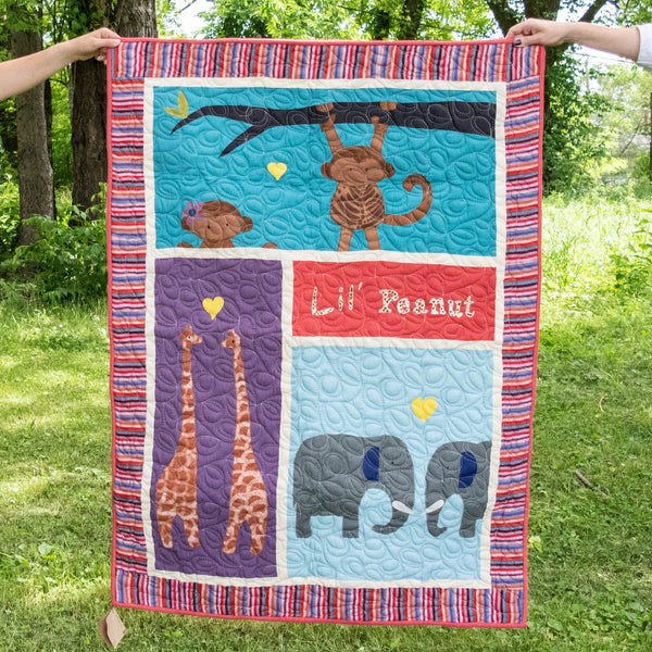 hand-stitched baby quilt outside amani chattanooga