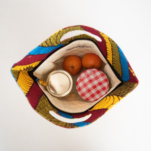 inside view of Colorful African Lunch Bag holding oranges and cans for size