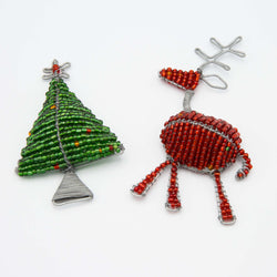 tree and reindeer Christmas Magnet on a white surface
