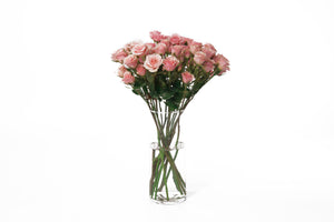 Pink spray roses in their vase. Pink spray roses are known for expressing gentle emotions like gratitude, joy and admiration.