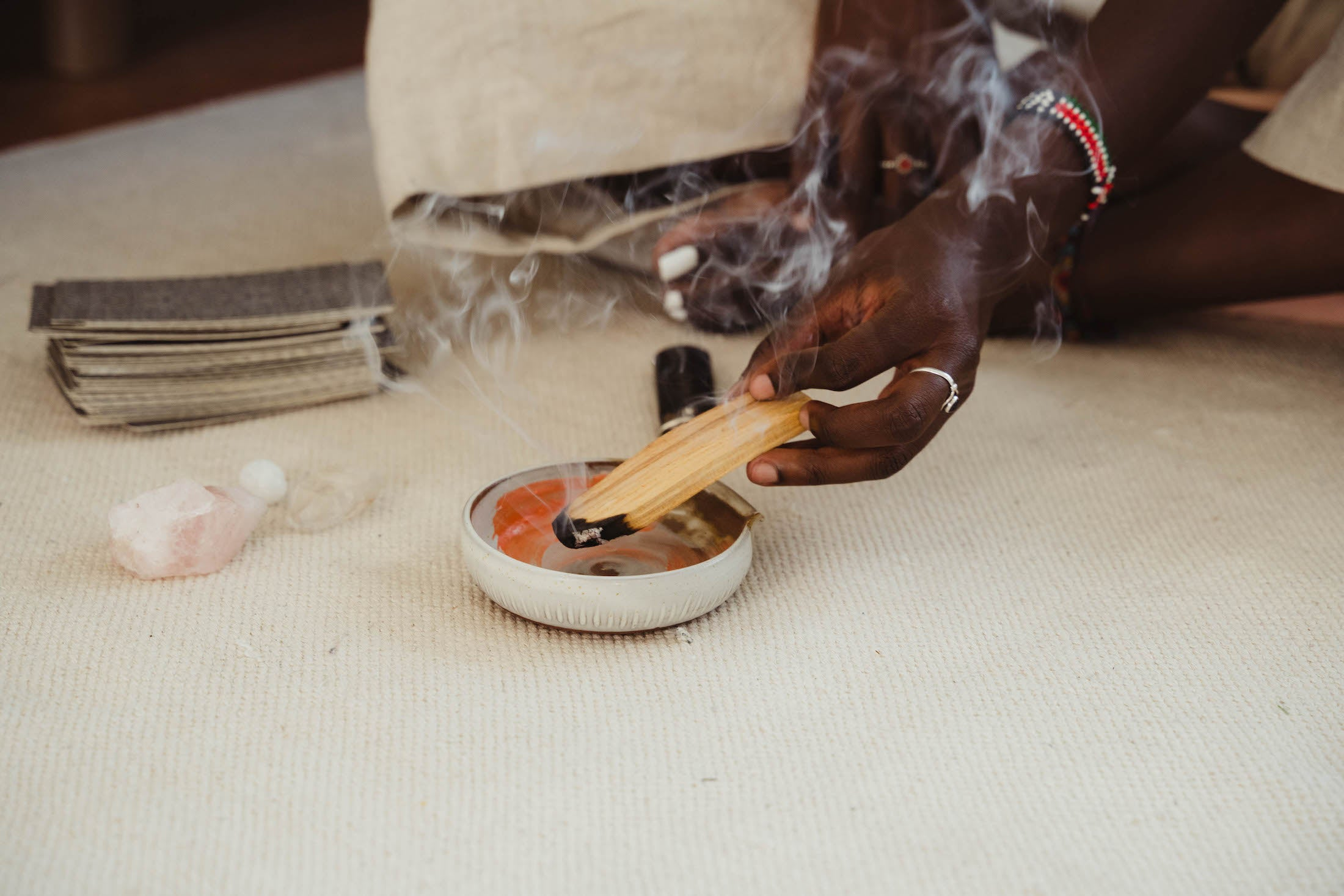 burning palo santo in a tray