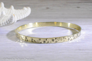 solid gold bangle bracelet with hand stamped floral design one of a kind personalized jewelry