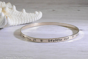 solid gold bangle bracelet hand stamped with Breathe in breathe out move on yoga om namaste