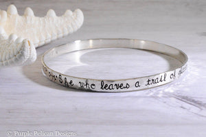 she who leaves a trail of glitter is never forgotten sterling silver bangle bracelet hand stamped jewelry custom personalized jewelry purple pelican designs