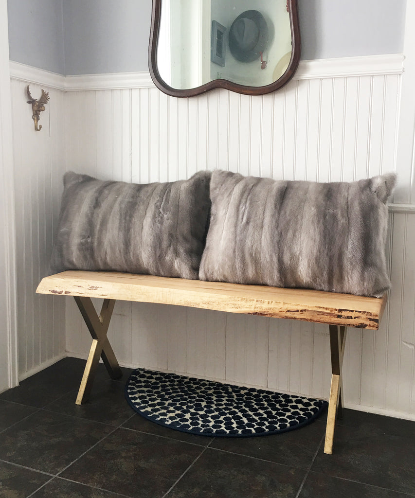 Two gray mink pillows made from an old fur coat in Canada
