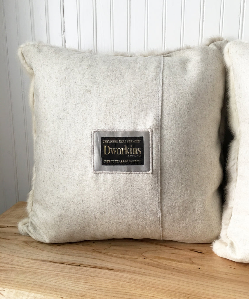 Detail of the back of the pillow. Original brand label Dworkins has been embroidered