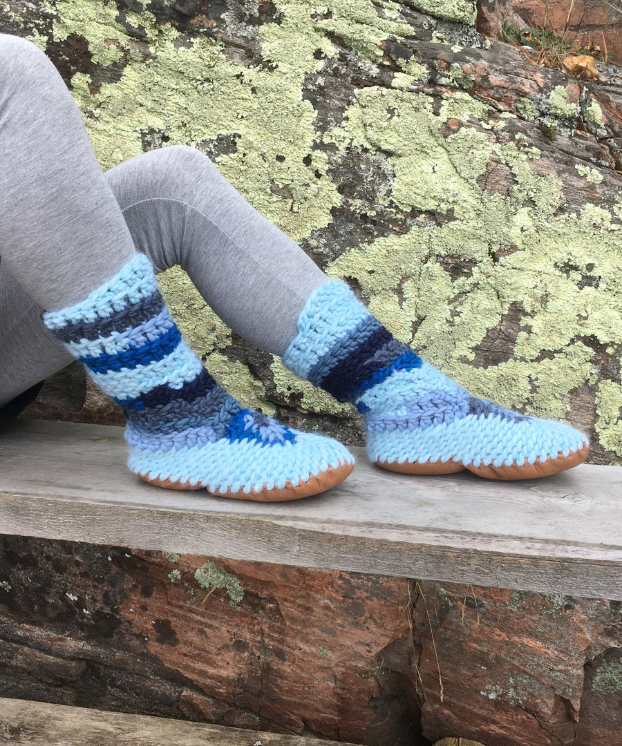 Tall slipper-boots in blues ranging from a light pastel blue to denim blue, to bright ocean blue. Handmade in Canada.