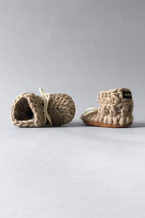 knit slipper boots for baby with shoe lace, handmade in canada with merino wool in taupe for eco friendly baby