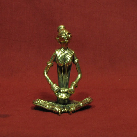 Dhokra/Dokra Art,Hand crafted,Tribal art. Ladies Musician sitting.