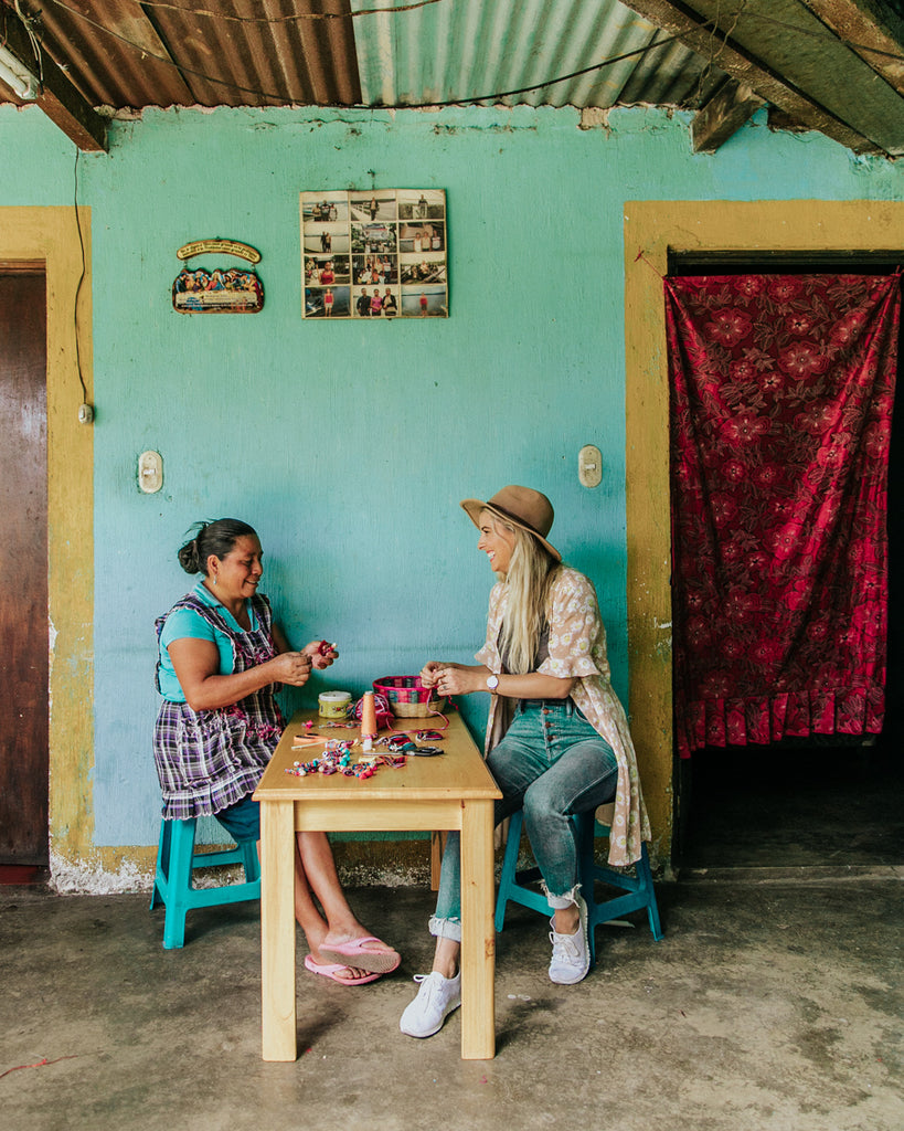 Hiptipico Founder Alyssa sharing with Artisan Women during volunteering day with Ninos de Guatemala