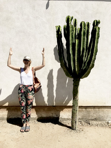 Alyssa standing in a cactus pose in front of a large cactus in Old Town.