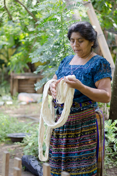 Long-term artisan partner Rosa prepares textiles for dying, authentic naturally died products, Guatemala ethical fashion, maya weavers
