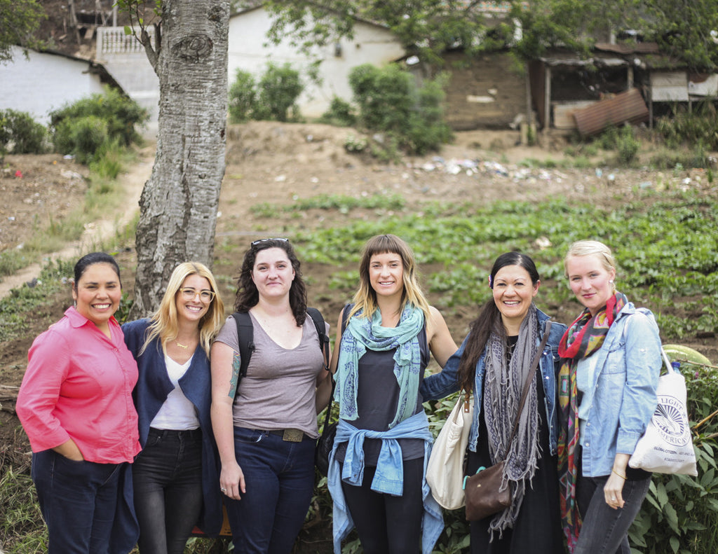 Tour participants pose with Hiptipico founder Alyssa in rural Guatemala, most transparent travel companies in Guatemala, how to experience Guatemala authentically, guatemala travel blogs, ethical travel bloggers