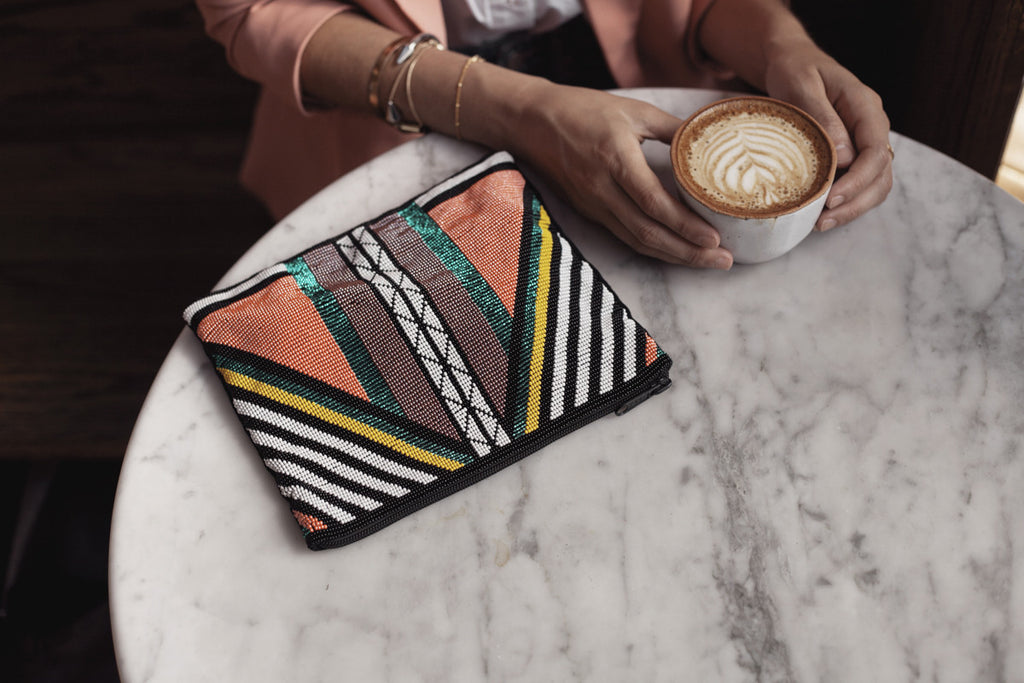 Style blogger @uniquelyyani styles a Hiptipico beaded clutch in a coffee shop for a daytime trendy look, beaded clutches, coolest clutches online, best ethical clutch picks
