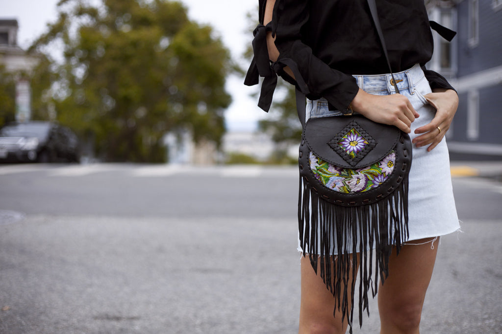 Style blogger @uniquelyyani styles Hiptipico on the streets of San Francisco for a style that transitions from day to night, ethically crafted handbags, artisan crafted leather bags, coolest fringe leather cross body bags,