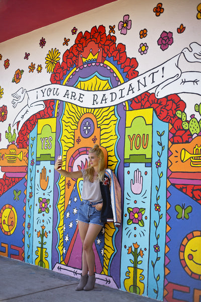 """You Are Radient"" mural in North Park, California with fashion blogger Alyssaya posing in front of it."