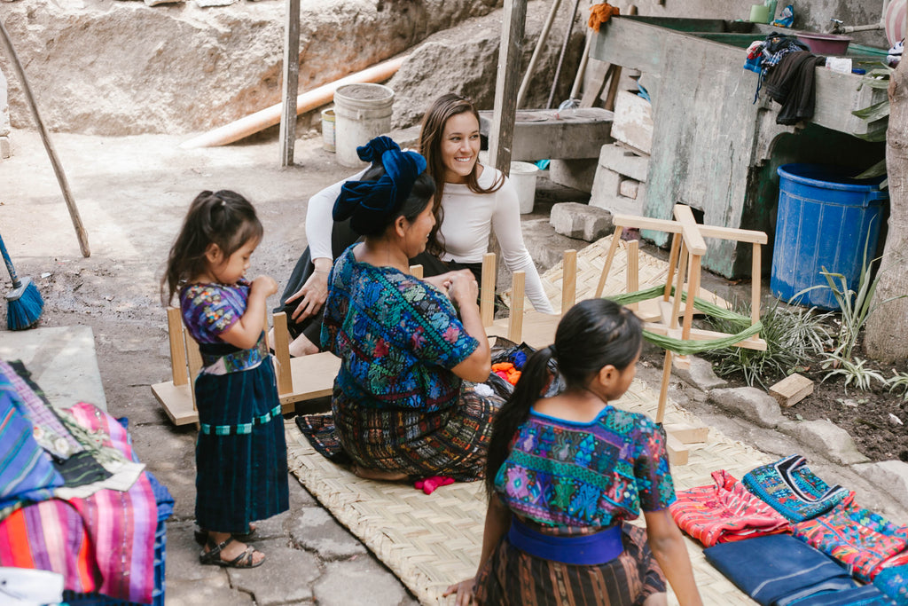 She Is Not Lost blogger Carina Otero converses joyfully with long term artisan partner Teresa and her family, weaving tours, artisan home visits, weaving workshops, ethical travel programs, ethical travel bloggers