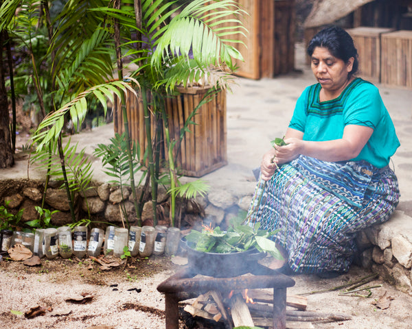 Artisan partner Rosa prepares leaves to boil to dye fabric naturally, blogs about natural dyeing process, naturally died accessories, textile sourcing with natural dyeing options, natural dyeing workshops