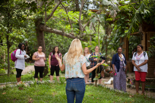 Hiptipico founder Alyssa Yamamoto speaks to participants of natural dying workshop in lush garden, weaving opportunities, how to learn about maya weaving, tz'utujil culture, ethical fashion blogs