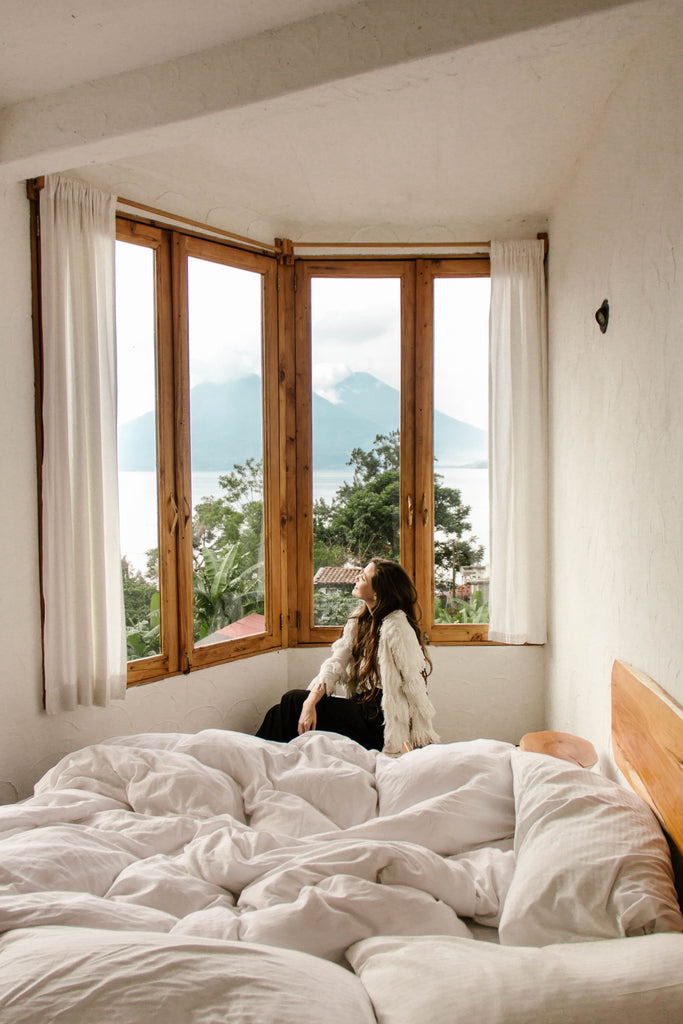 She Is Not Lost blogger Carina Otero admires the view of Lake Atitlan from her bedroom window at Lush Atitlan, where to stay on Lake Atitlan, ecoresorts in Guatemala, boho chic hotels Guatemala, cutest bohemian hotels, hiptipico ethical travel