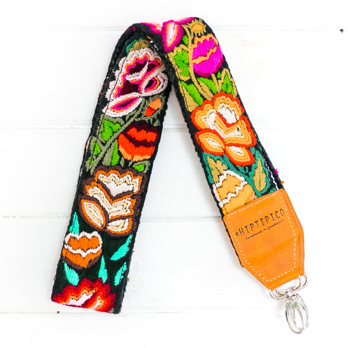 hiptipico camera strap & leather bag, ethical travel gear, flat lay travel inspo, ethically sourced  Hiptipico camera strap, wearable art, colorful landscape, hand woven straps, bohemian camera strap