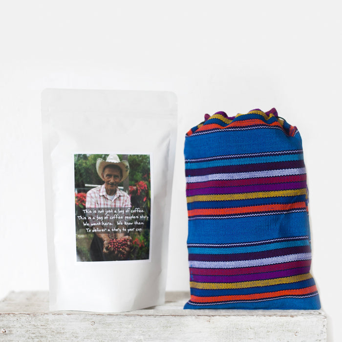 Coffee packaging with farmer's photo on the label next to a colorfully woven drawstring back to hold your beans, Cafe loco coffee, buy coffee online, fair trade coffee guatemala, shop guatemalan coffee, hiptipico coffee, roasted coffee beans, fair trade gift ideas
