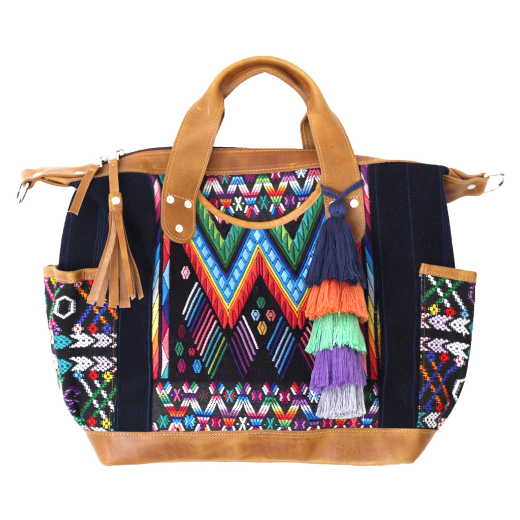 Hiptipico Travel Bag with Colorful Diagonal Patterns and Assorted Poms, Poms handmade in central america, pompom charms, ethically produced pompoms