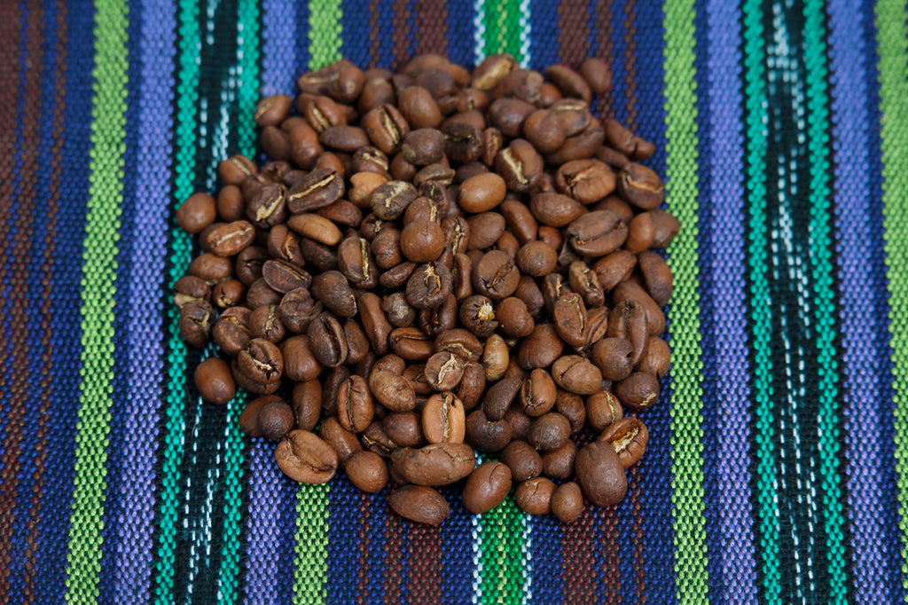 Coffee beans arranged in circle on guatemalan textile, Hiptipico Fair Trade Coffee, Cafe Loco Panajachel Coffee, Buy Fair Trade Coffee Online, Coffee Lover Gift Idea, Purchase Guatemalan Huehuetenango Coffee
