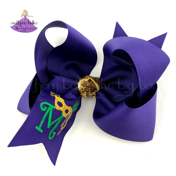 Big Yellow Mardi Gras bow with glitter and gold masks, beads, fleur-de-lis and a purple feather center