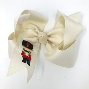 Large Ivory Nutcracker Christmas Hair Bow for Girls - Alligator Clip Right