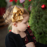 Gold glitter hair bow for little girl