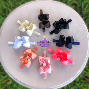 Baby headband bows made in the southern twisted boutique bow style with big bows in various colors