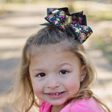 Black Mardi Gras Hair Bow with Gold Foil, Masks, and Fleur-de-lis Accents