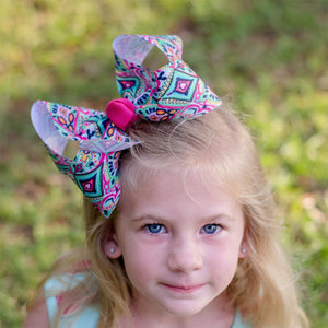 Big boutique bow with bohemian ikat pattern in pink, mint, white, and black