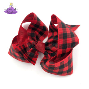 Buffalo plaid hair bow in red and black checks made in boutique bow style