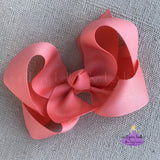 Coral hair bow made in the twisted boutique bow style