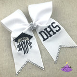 White graduation cap bow with metallic silver accents and bling