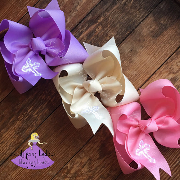 Lavender, Ivory, and Pink Easter Hair Bows with embroidered crosses made in the twisted boutique bow style