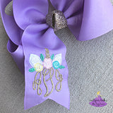 Big lavender unicorn hair bow that is personalized with an embroidered monogram