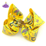 Big Yellow Mardi Gras Bow with Mardi Gras Masks and Metallic Gold with Glitter Accents