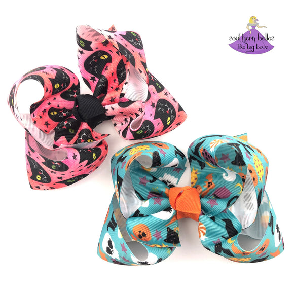 Halloween Hair Bows for Girls in Pink and Turquoise made in twisted boutique bow style