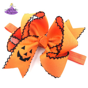Halloween Headband Baby Girl with Embroidered Jack-O-Lantern and decorative scalloped edge moonstitch