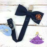 Navy blue and orange monogrammed bow tie pacifier clip with diamond monogram