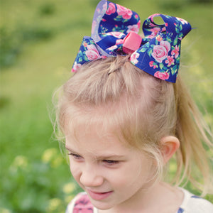 Big navy boutique bow in floral pattern with rose blooms and other florals