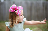 Big pink hair bow for girl with bright floral pattern print