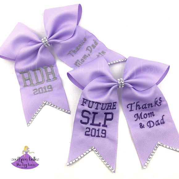 Light purple lavender graduation cap topper bows with custom personalization and rhinestone bling