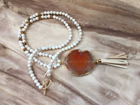 Orange druzy and tassel