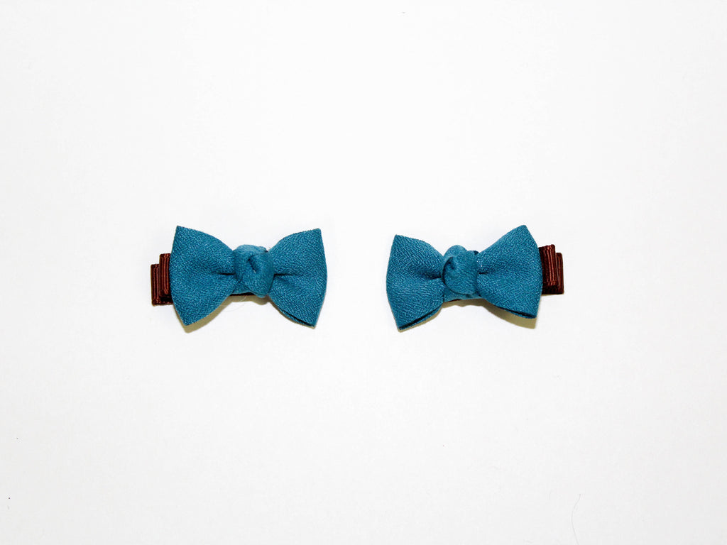 turquoise mini bow duck clips