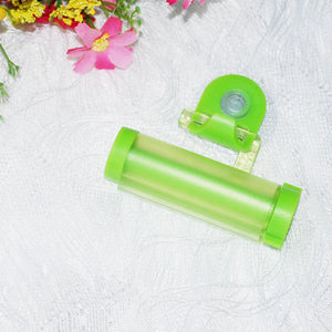 1 pc Plastic Rolling Tube Squeezer Useful Toothpaste Easy Dispenser Bathroom Holder Free Shipping